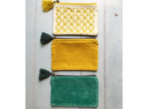 Tassel purse in mustard, teal and white with mustard.