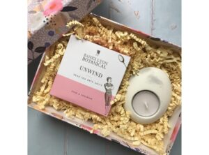 Curated gift box including Banks Lyon Botanical Dead Sea Bath Salts and a concrete tea light holder and tea light from Simple Home. Floral good quality gift box.