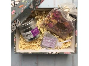 Gift box decorated with butterflies containing candle in a tin, travel lavender soap and scented botanical sachet. Made in Bedfordshire.