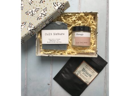 Gift box with face mask, charcoal and orange soap and bath salt sachet.