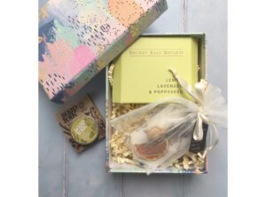 pastel coloured gift box with wax scented tablet, bath infusion and soap folk lemon lip balm.